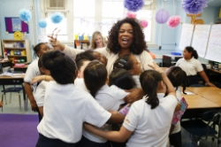 Oprah with Public Prep Charter School Students