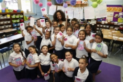 Oprah Visits Public Prep Charter Schools and Poses with Students