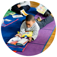 Student in Independent Reading at Public Prep All Boys School Bronx